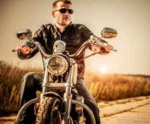 man-on-motorcycle-on-road